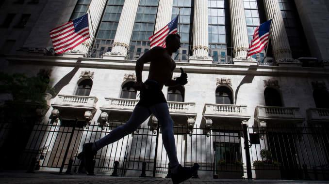 A jogger passes in front of the New York Stock Exchange (NYSE) in New York, U.S., on Wednesday, June 17, 2020.