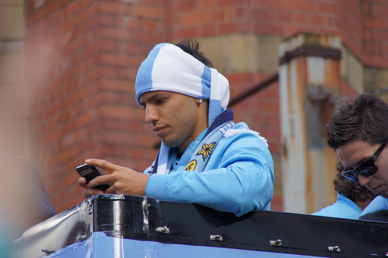 1280px-Aguero_sending_photos_-_Premier_League_parade_2011-12.jpg