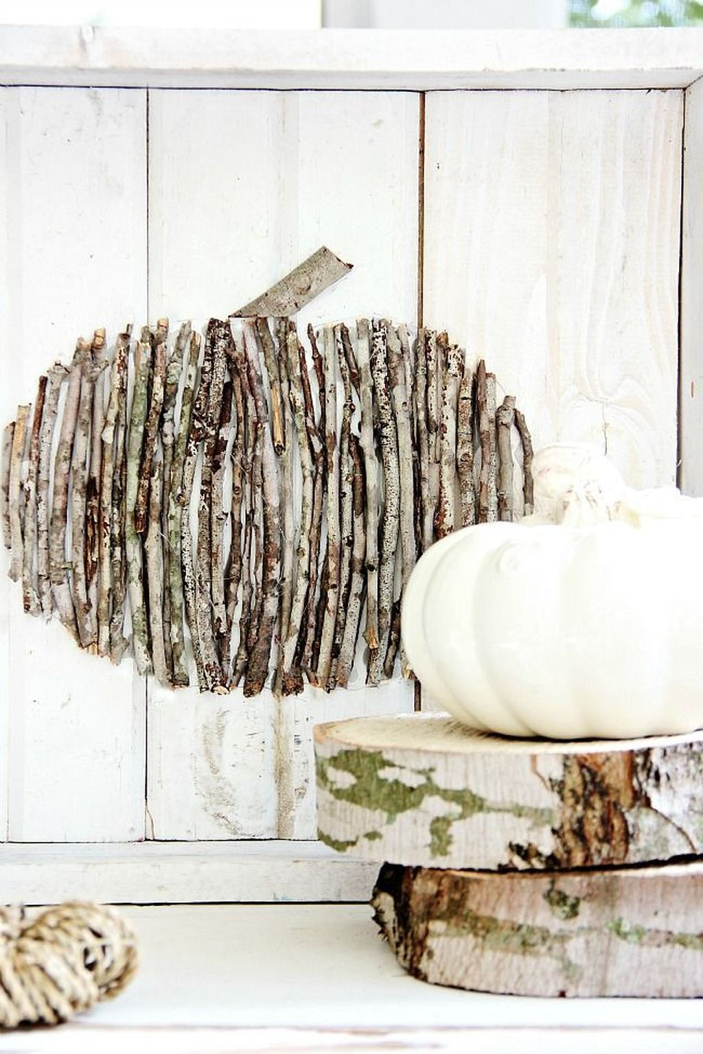 DIY pumpkin craft idea for farmhouse kitchens. a pumpkin shape is formed using different sizes of sticks