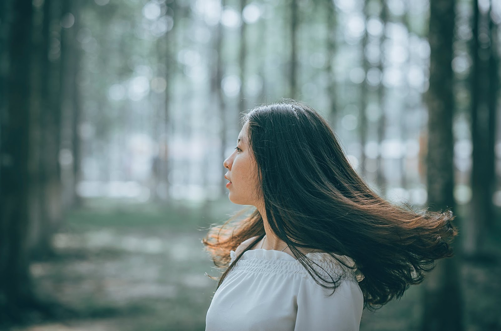 woman with stunning thick black hair in wind.