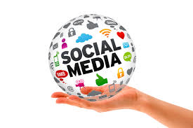social media words in a ball being held by a hand