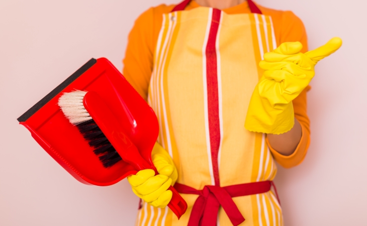 a woman has her cleaning supplies and is ready to work on her move out cleaning checklist