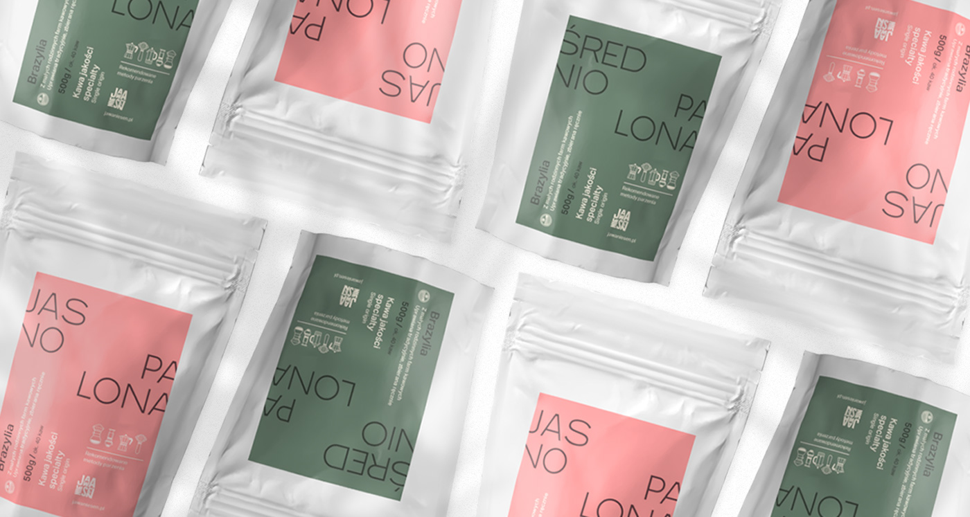 Top view of eight coffee pouches featuring green and pink labels