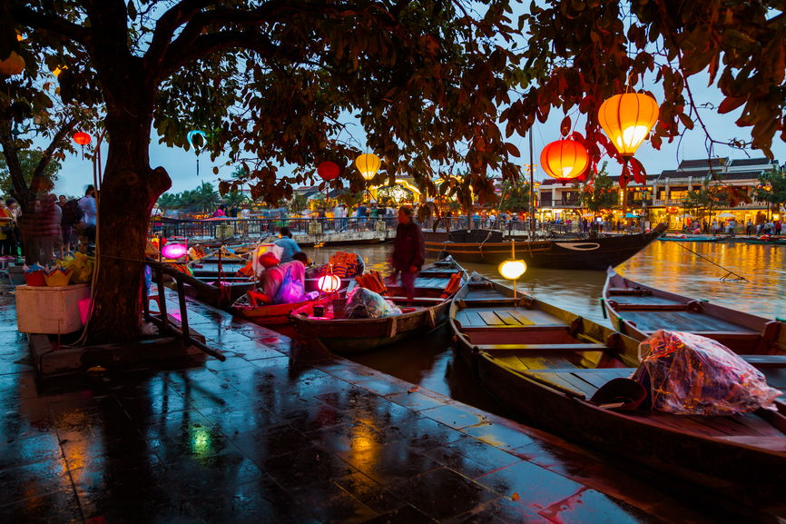 6 Best Places to Visit in Asia in 2020 featured by top travel blog, The Common Traveler: image of boats on river in Hoi An, Vietnam