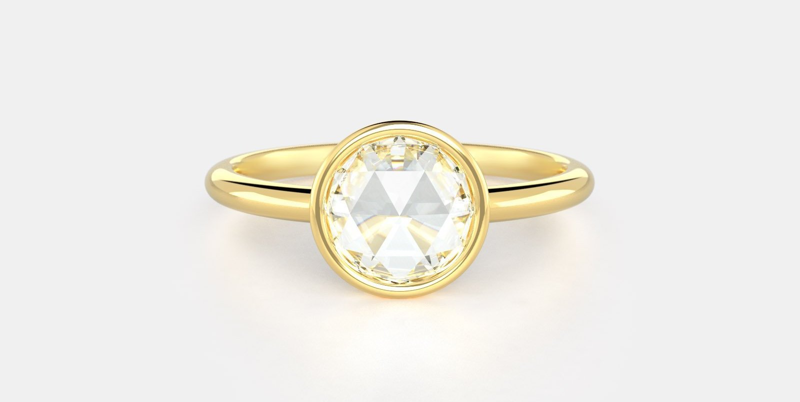 Billie. No. 5 a rose cut diamond set in a yellow gold band.