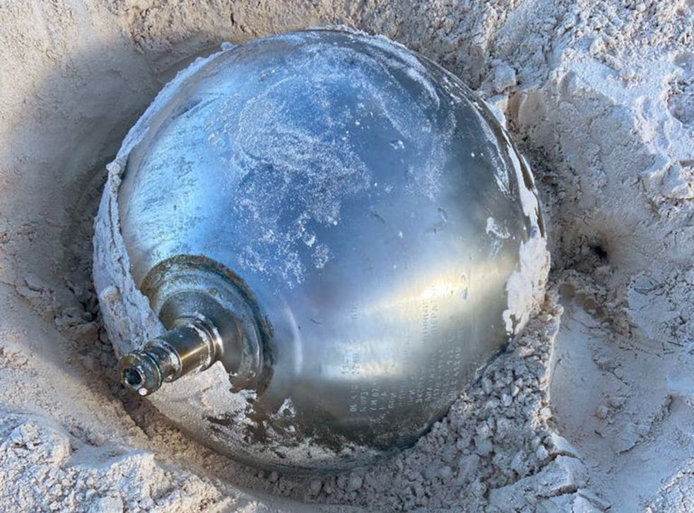 <p>Manon Clarke spotted the 41kg reflective ball poking out of the sand while walking with her family at Harbour Island</p>