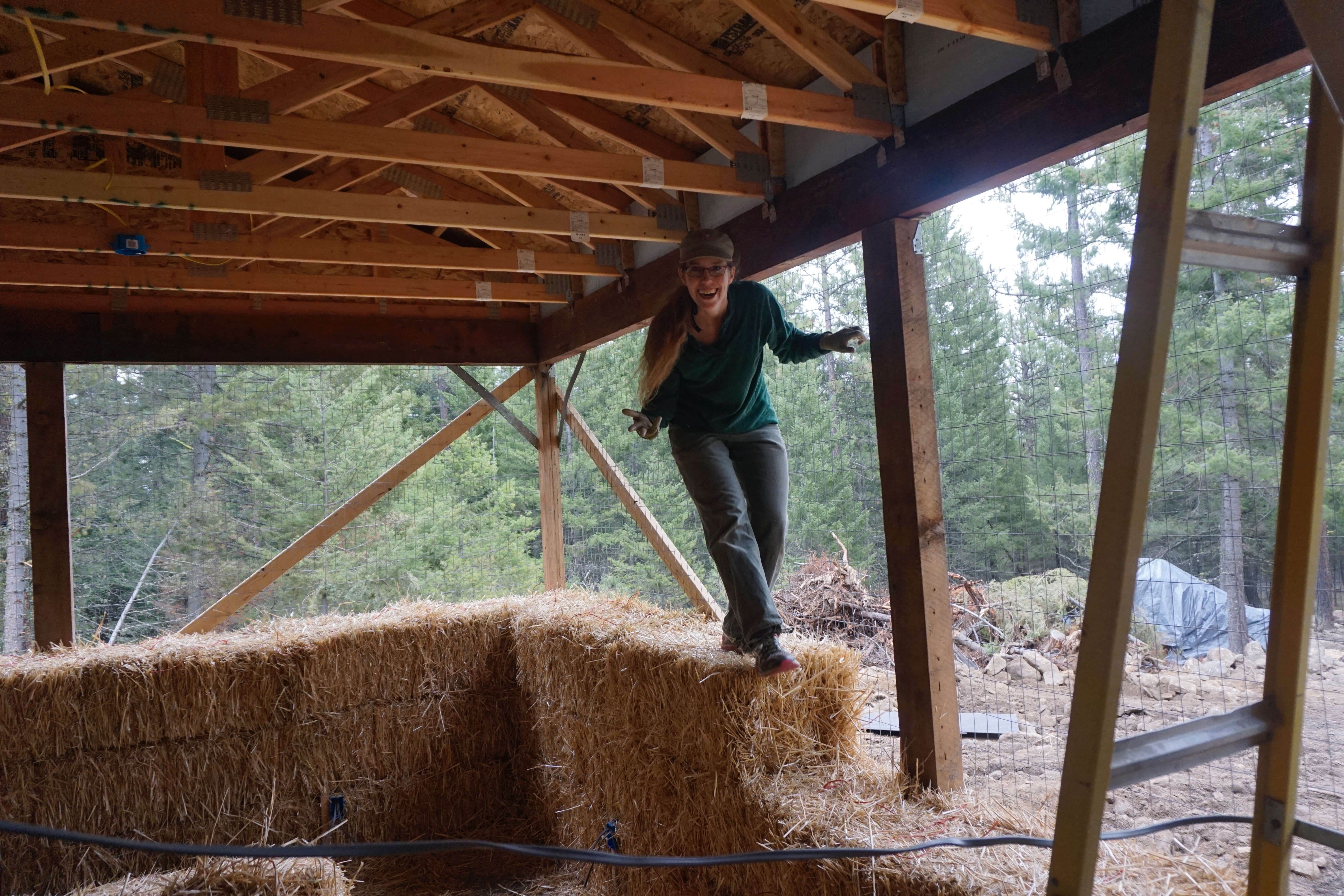 Having fun climbing the bales at a straw bale workshop with Walt Redfield in Fall 2016.