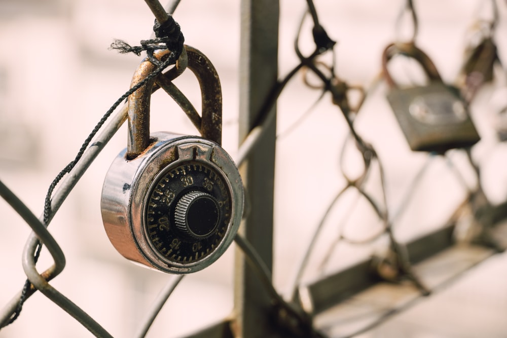 silver-colored padlock