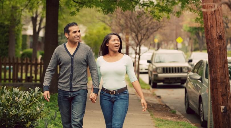 couple walking through neighborhood