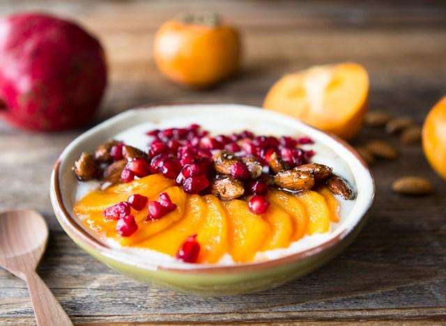 Persimmon pomegranate yogurt bowl