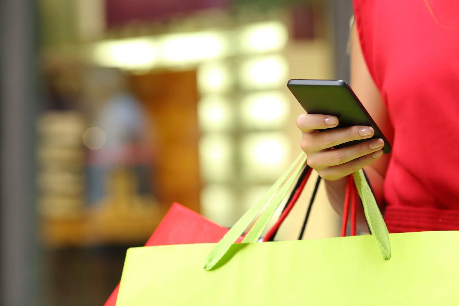Woman receiving Postscript text message marketing while shopping