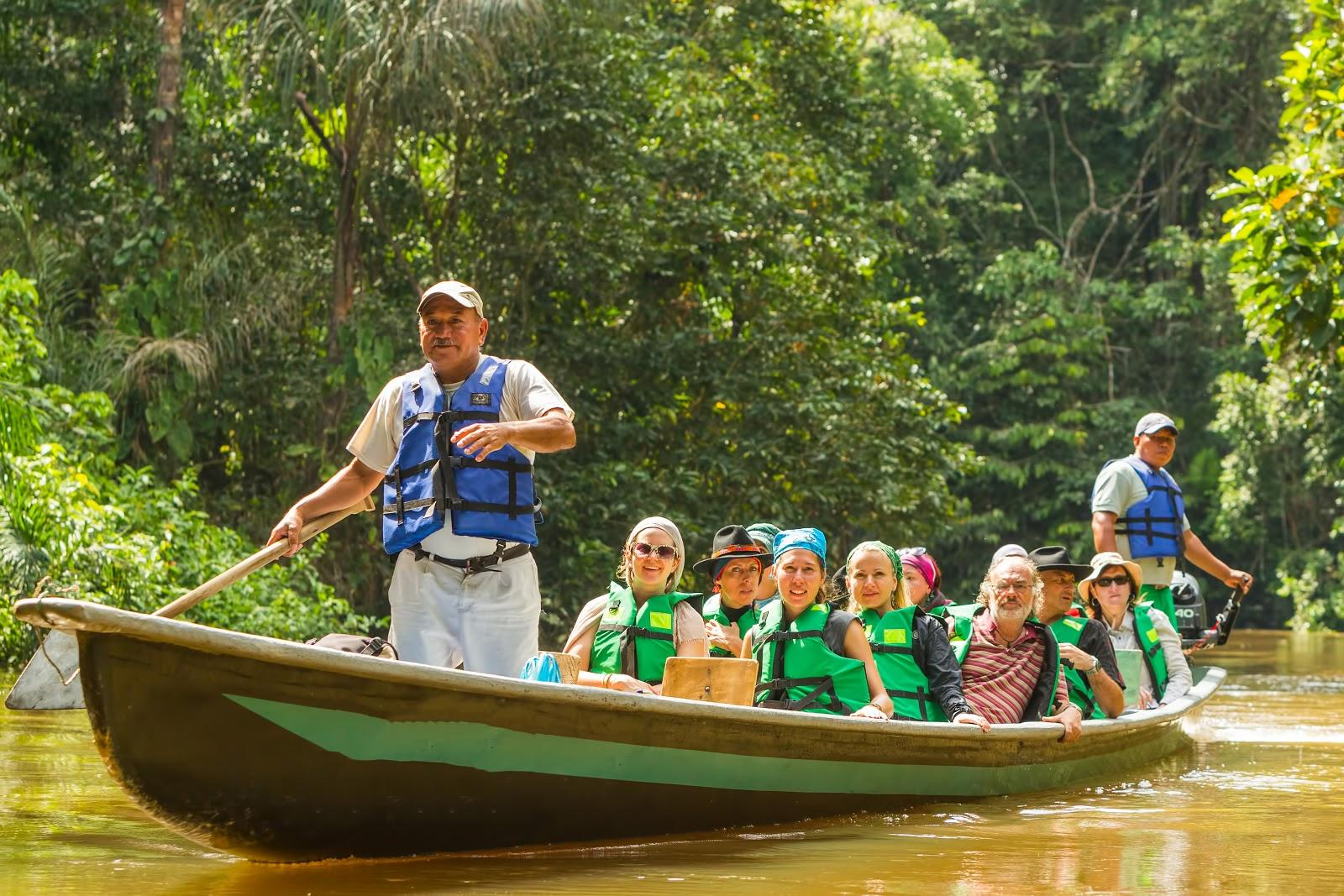 senior travelers rafting on the Amazon