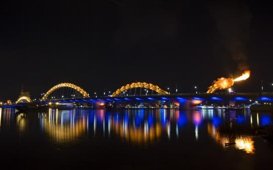 fire-breathing dragon bridge at night