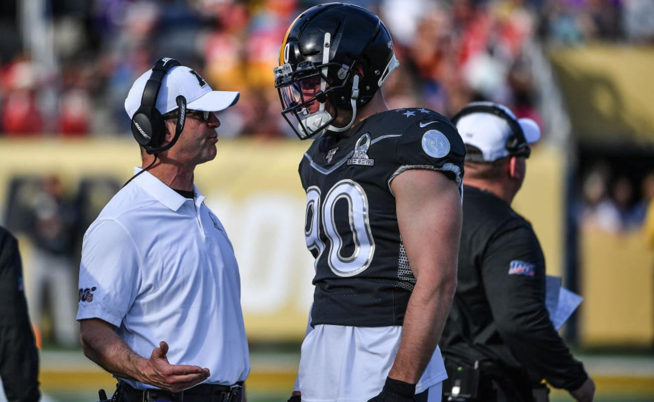 John Harbaugh Head Coach of the AFC speaks with T. J. Watt #90 of the Pittsburgh Steelers January 2020, Florida