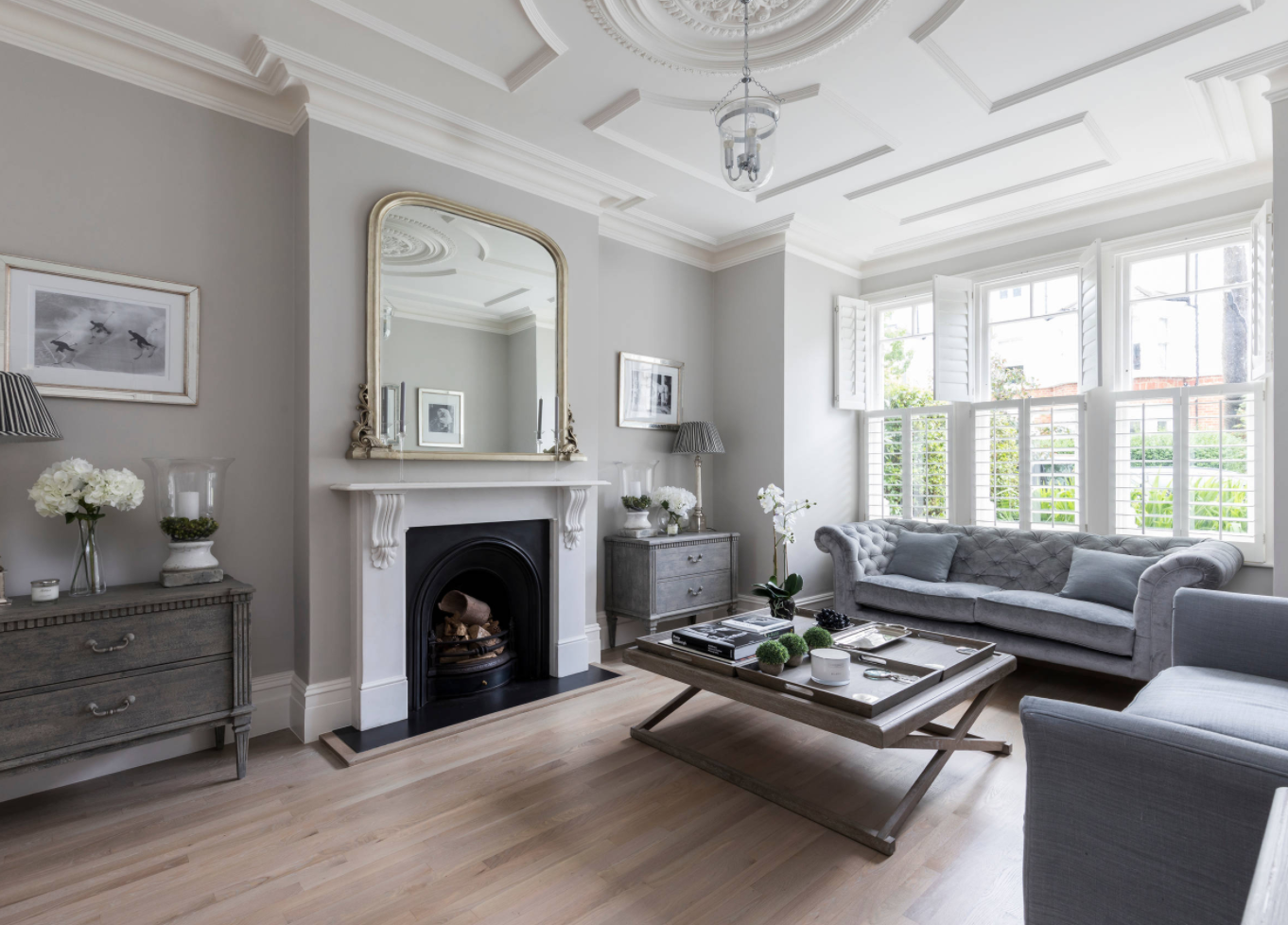 Neutral light grey living room in a West London period home.
