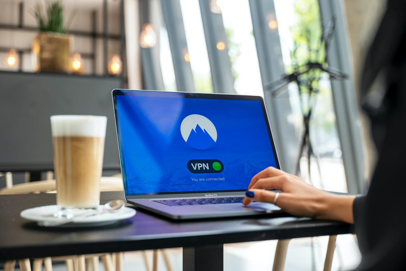 a woman using a VPN to research online
