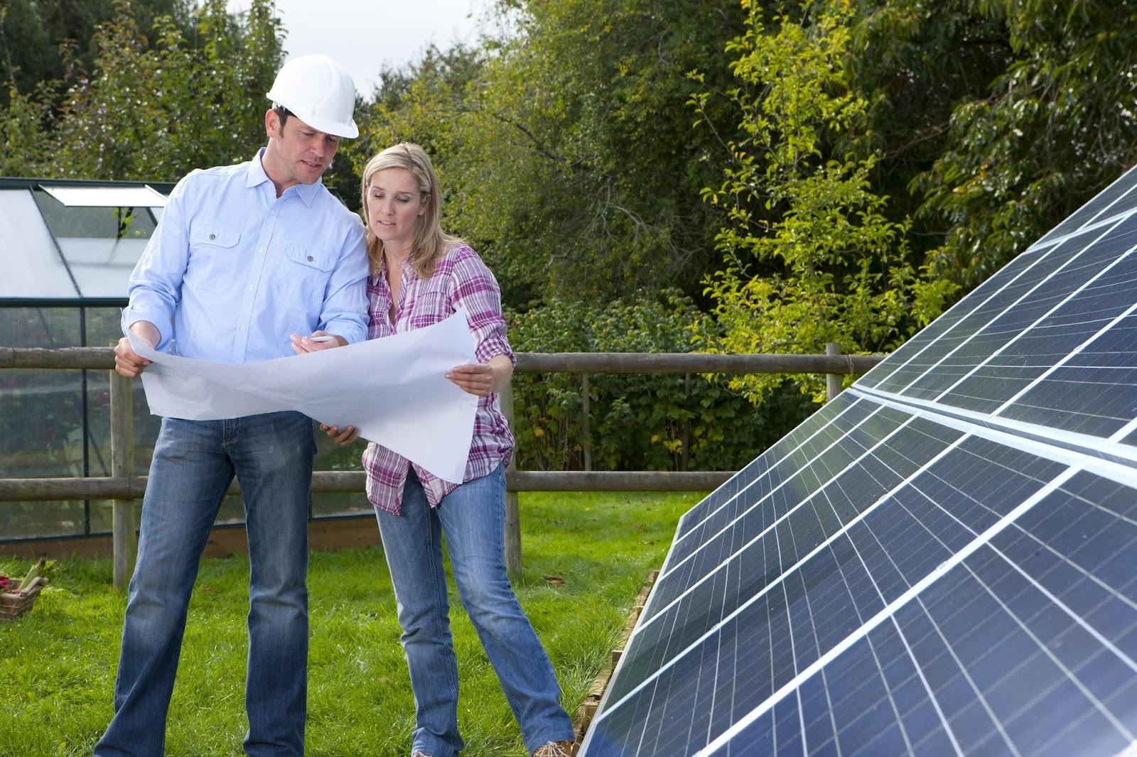 Installing solar panels-couple.jpg