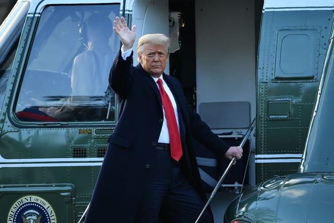 Outgoing President Donald Trump waves as he boards Marine One at the White House on Jan. 20, 2021. President Trump travels to his Mar-a-Lago golf club residence in Palm Beach, Florida, and will not attend the inauguration for President-elect Joe Biden.