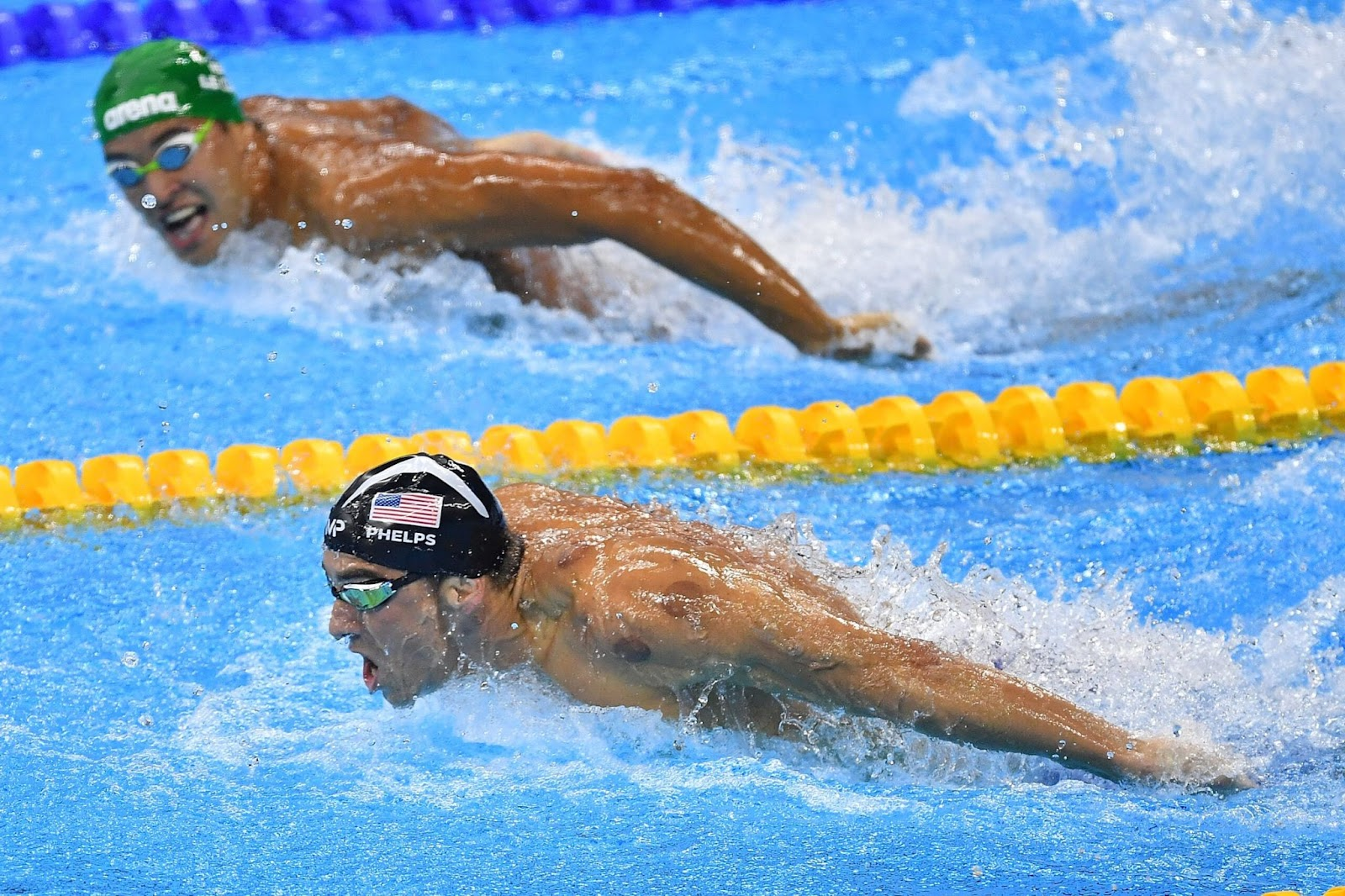 PICTURE OF LE CLOS LOOKING AT PHELPS IN THE OLYMPICS AND THEN MISSING GOLD