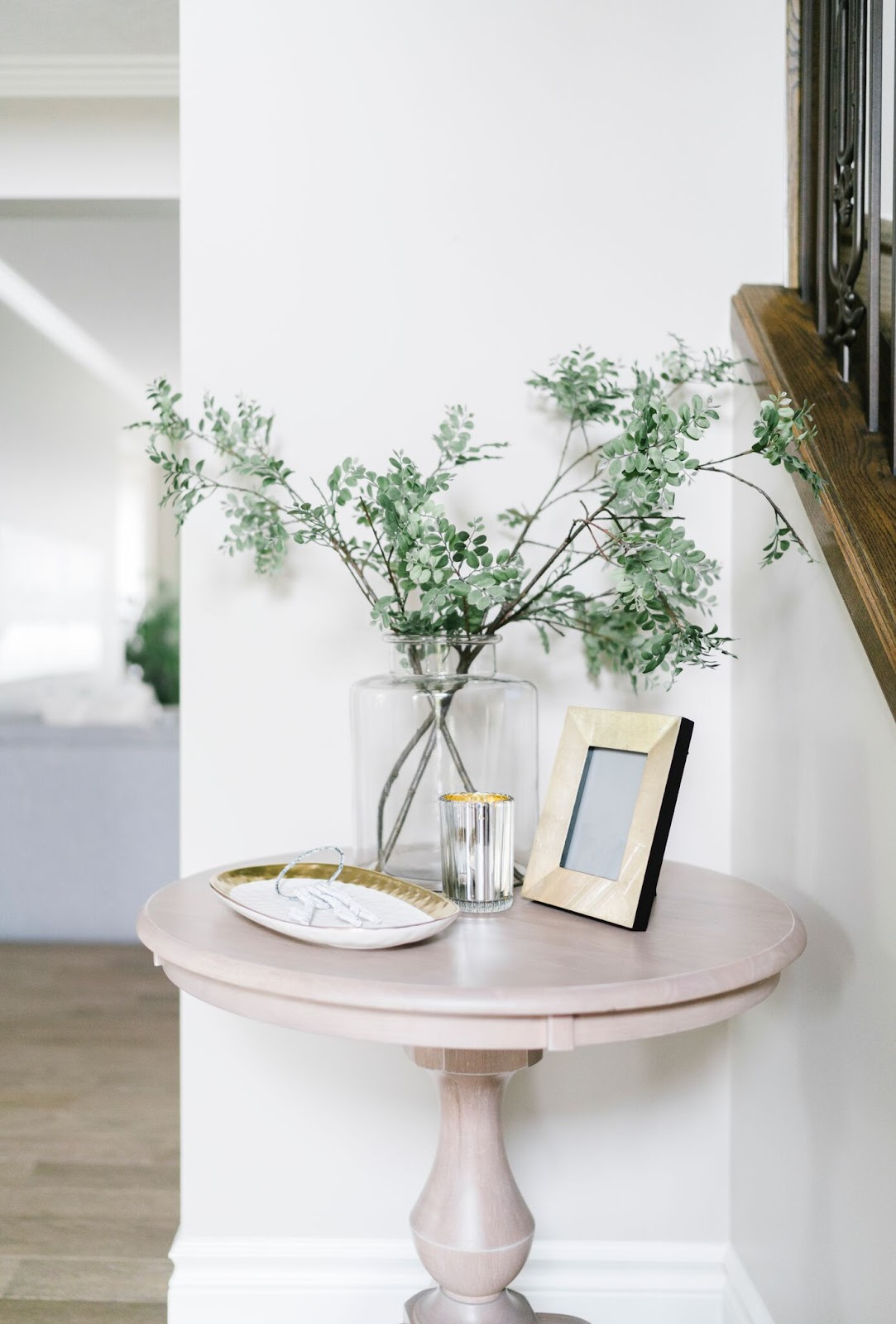 vignette frame accessories pink stone table branches vase calgary traditional contemporary design
