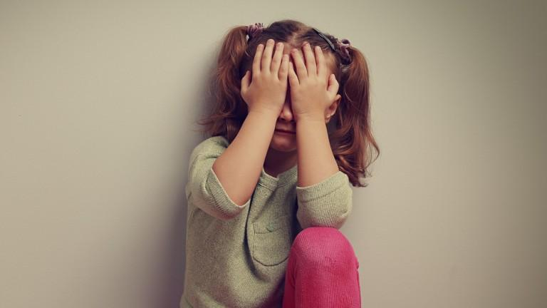 A child struggling with social anxiety