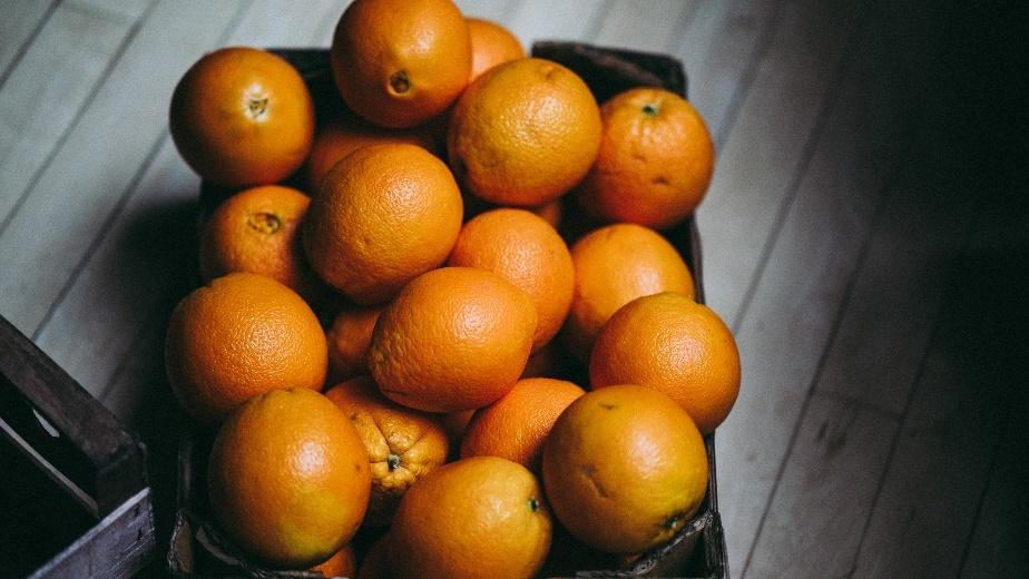 A bowl of oranges  Description automatically generated with medium confidence