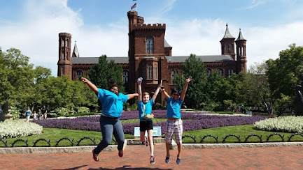 Chinese students leaping for joy at field trip to Smithsonian Museums in Washington, DC