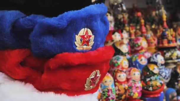 Popular Russian souvenirs - hats with ear-flops, Russian dolls