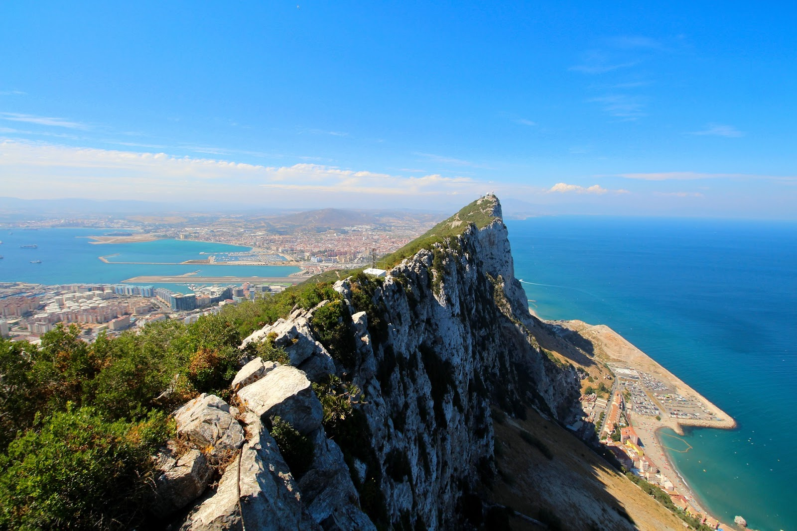 rock of gibraltar big mountain on small island city in background sunny day calm blue sea