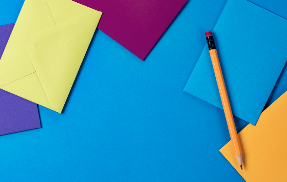 Colorful envelopes with a pencil is one of the best tools for blogging.