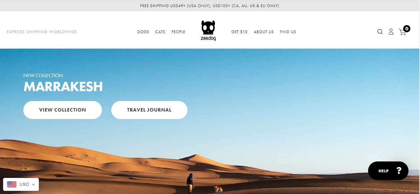 Zee.Dog's landing page - a man and a dog far away in a dessert
