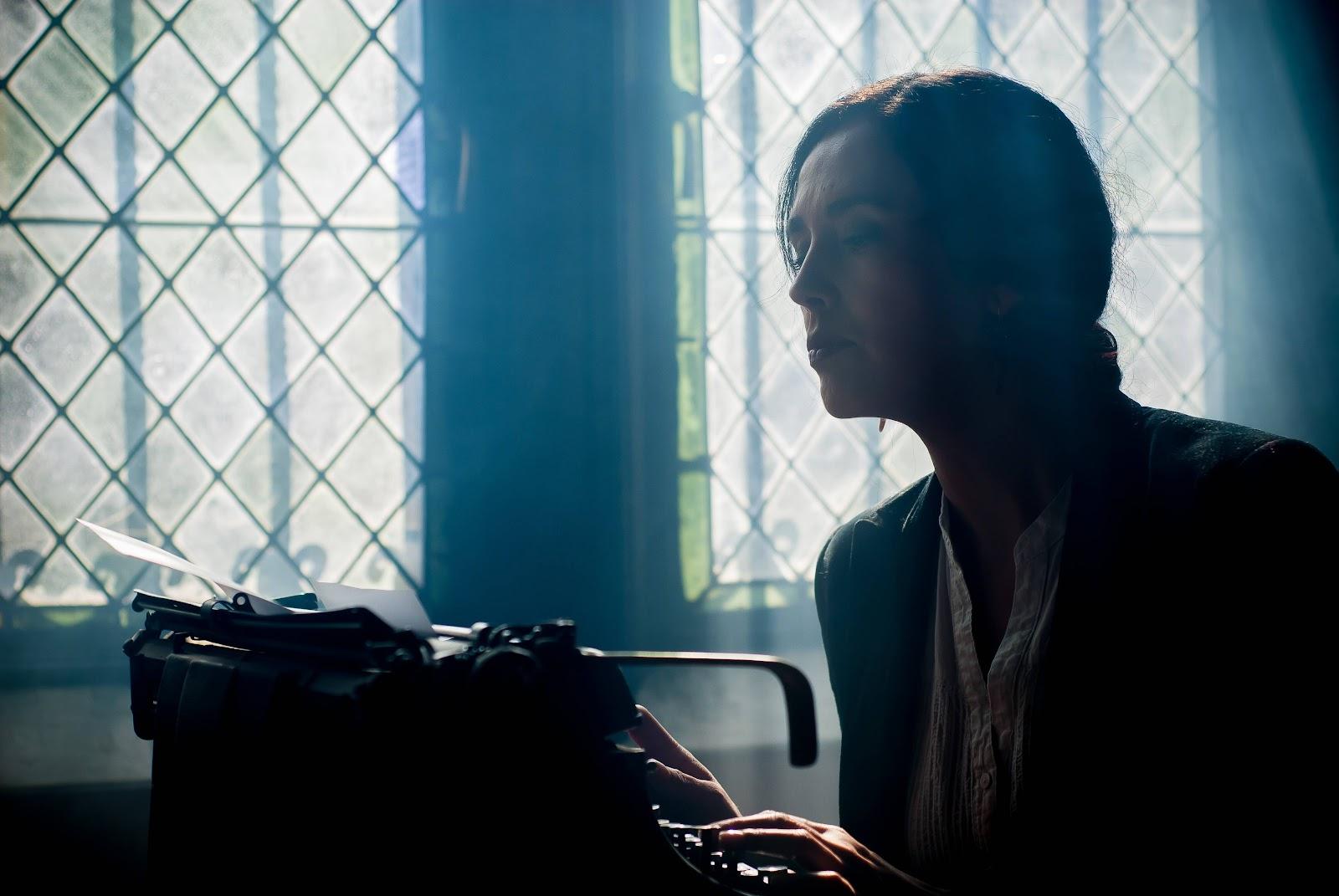 Girl writing dramatically on a type writer