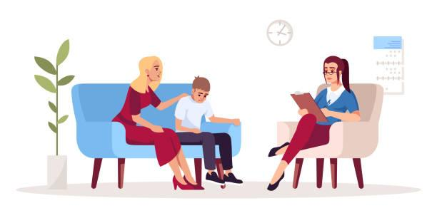 Mother with son at therapy session on psychologist