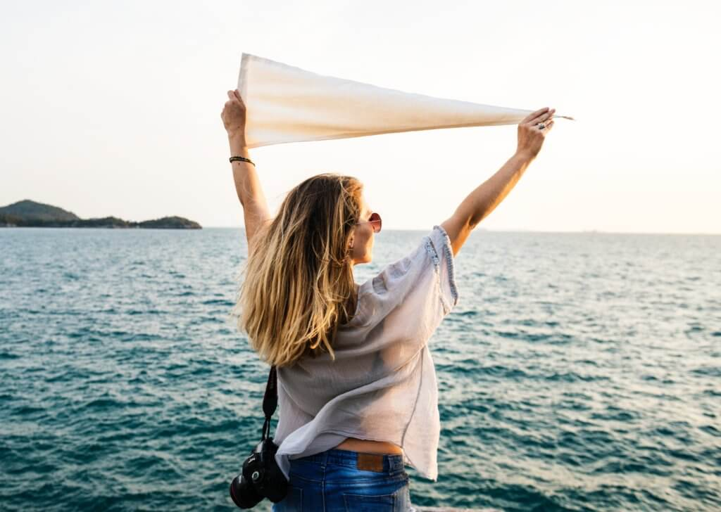 girl waving a white flag
