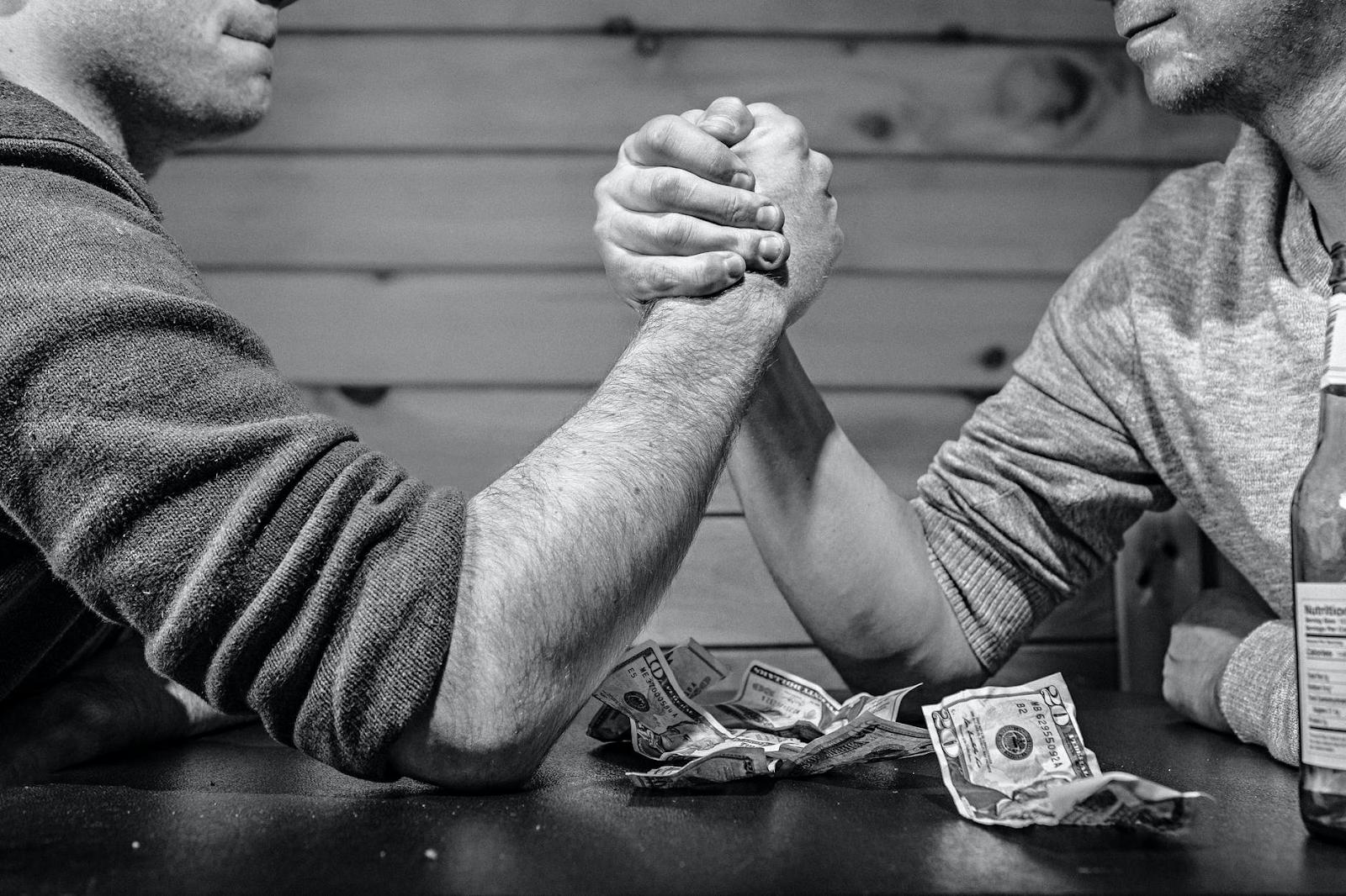 image showing two men hand wrestling