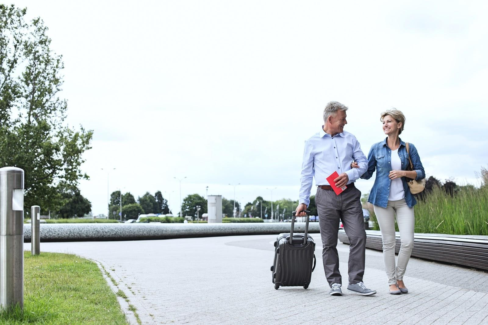 senior couple traveling with luggage