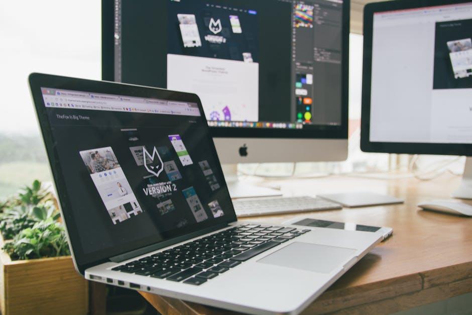 open laptop showing website design elements of a successful website