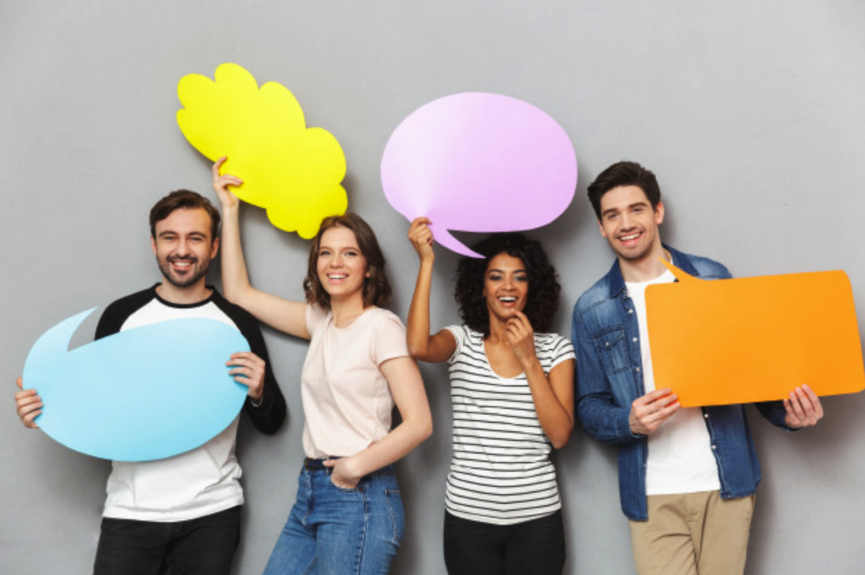 Happy influencers holding up speech bubble boards
