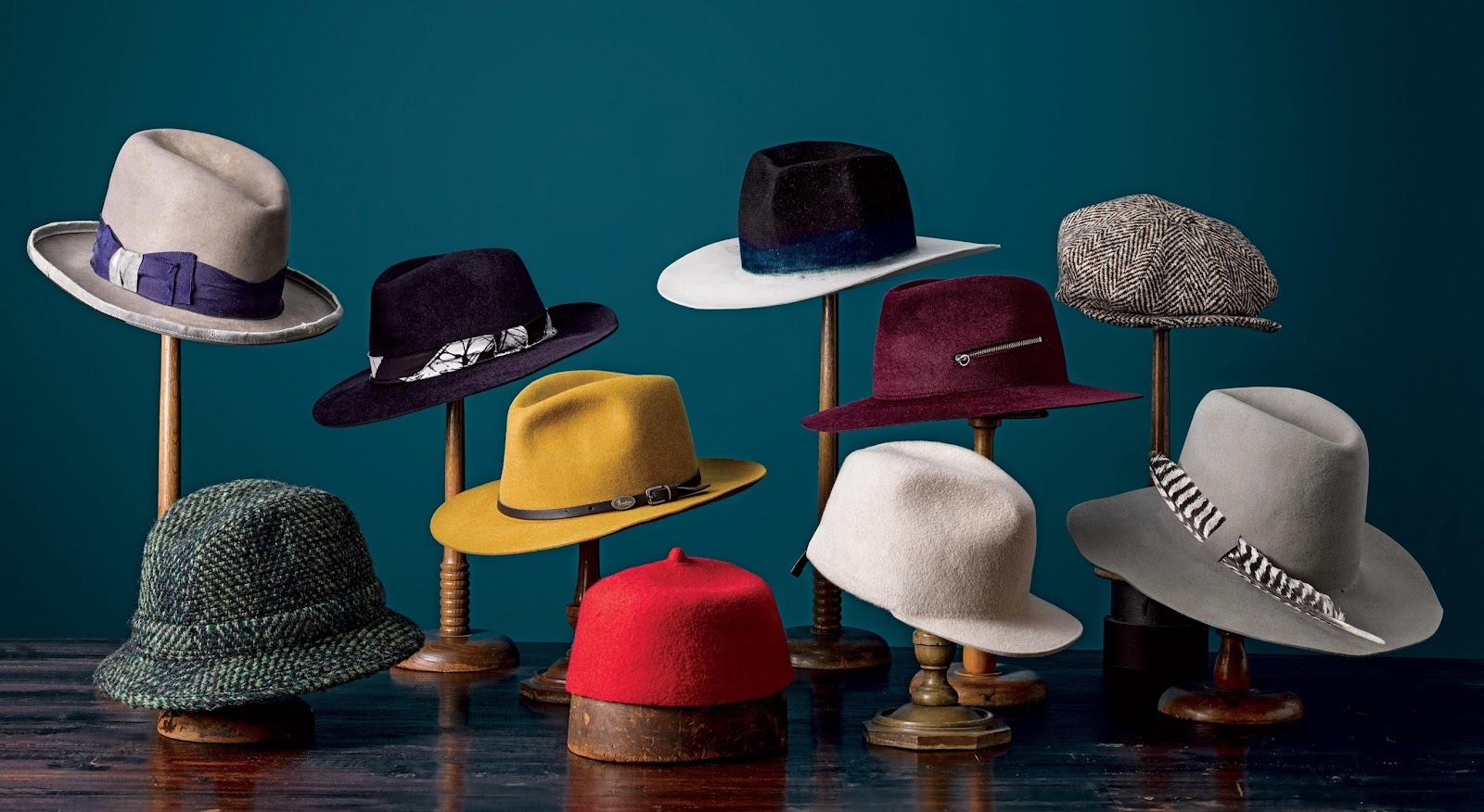 A group of hats on a table  Description automatically generated with low confidence