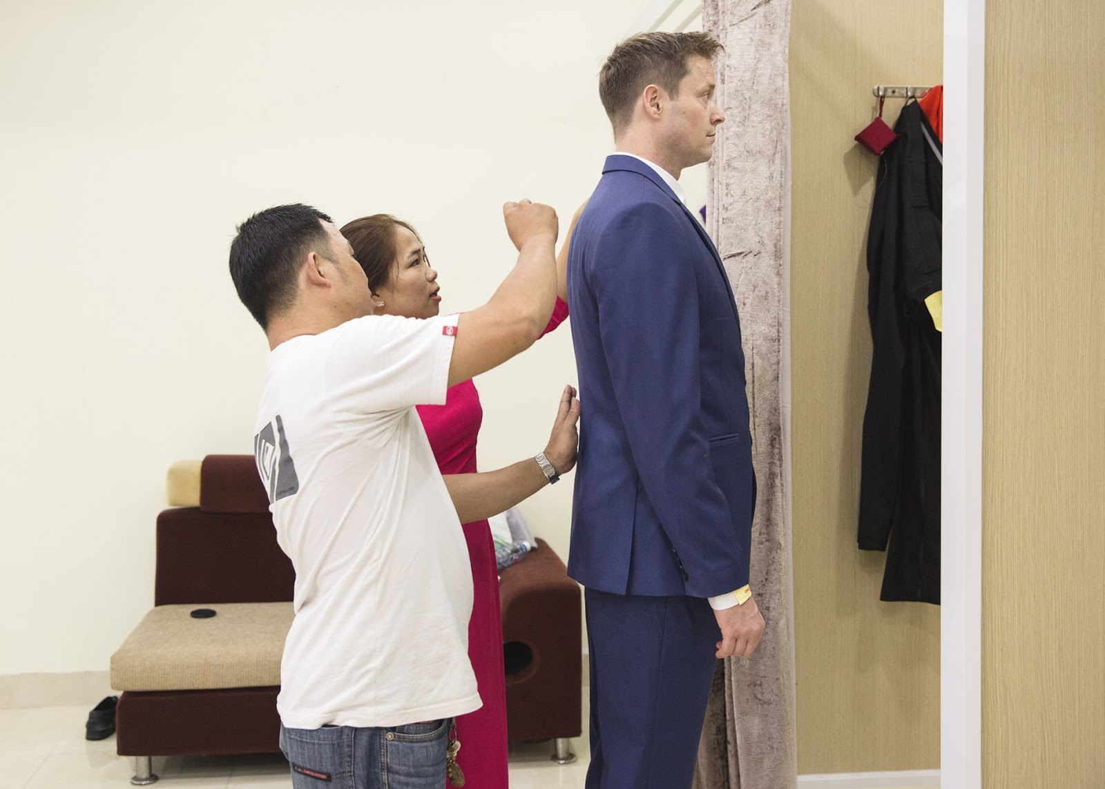 fitting a suit at Bebe.