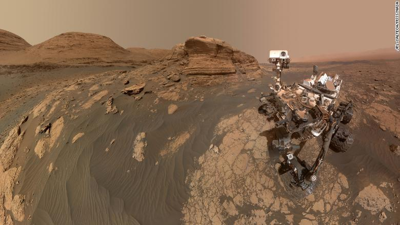 """NASA's Curiosity rover used two cameras to create this selfie in front of """"Mont Mercou,"""" a rock formation that stands 20 feet tall."""