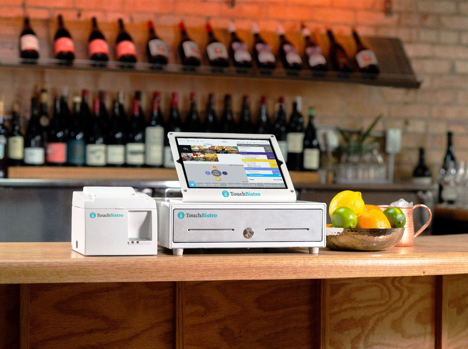TouchBistro POS, cash drawer, and printer on a bar counter