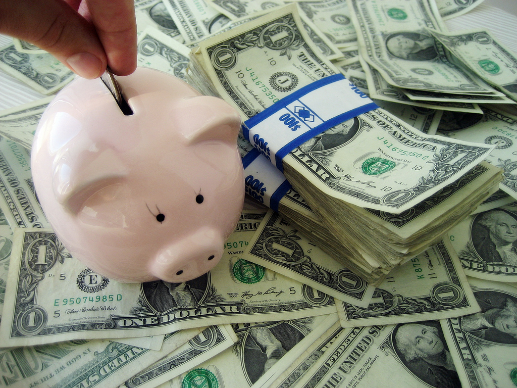 Money - Savings | Saving Money in a piggy bank for the futur… | Flickr