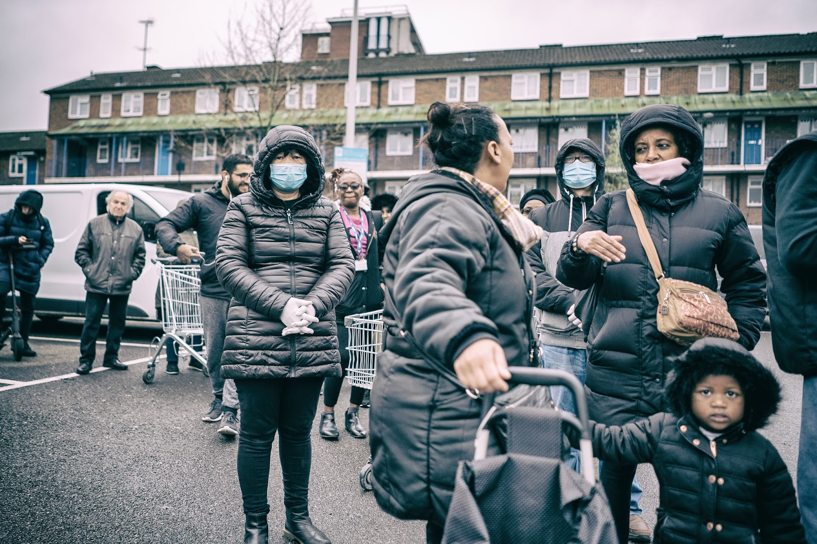 Local residents line up on an urban London street during the COVID-19 pandemic on March 19, 2020. Concerns about the UK's third wave affecting the vaccinated and children are reflected in the SPI-M-O report.