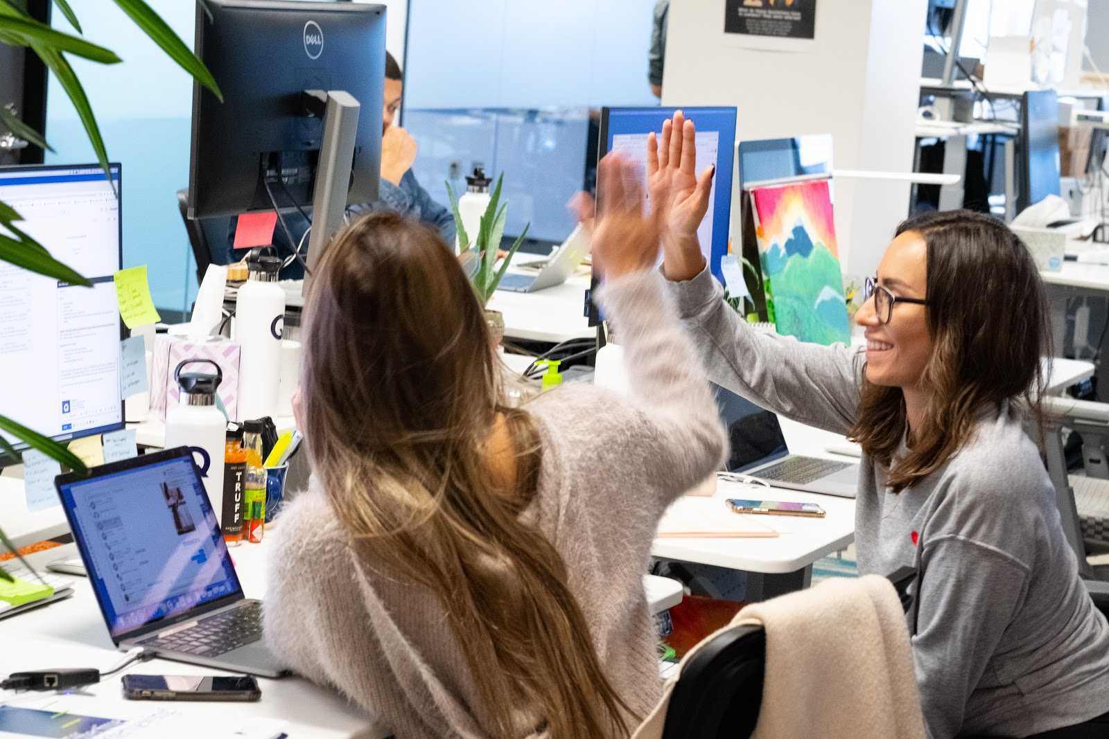 Quizlet employees at their office doing a high-five