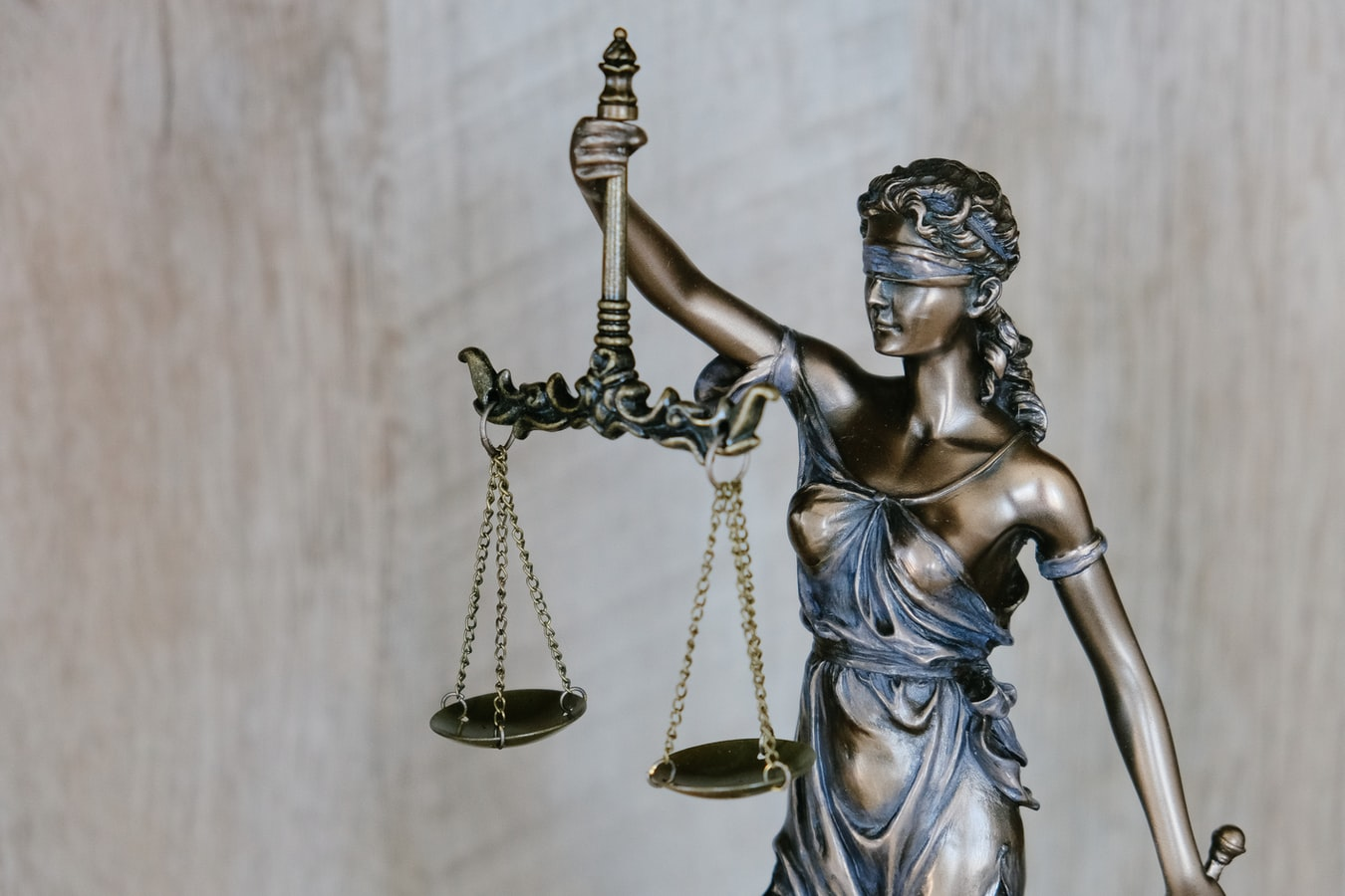 dropshipping legal requirements  as the statue of justice weighs the scales