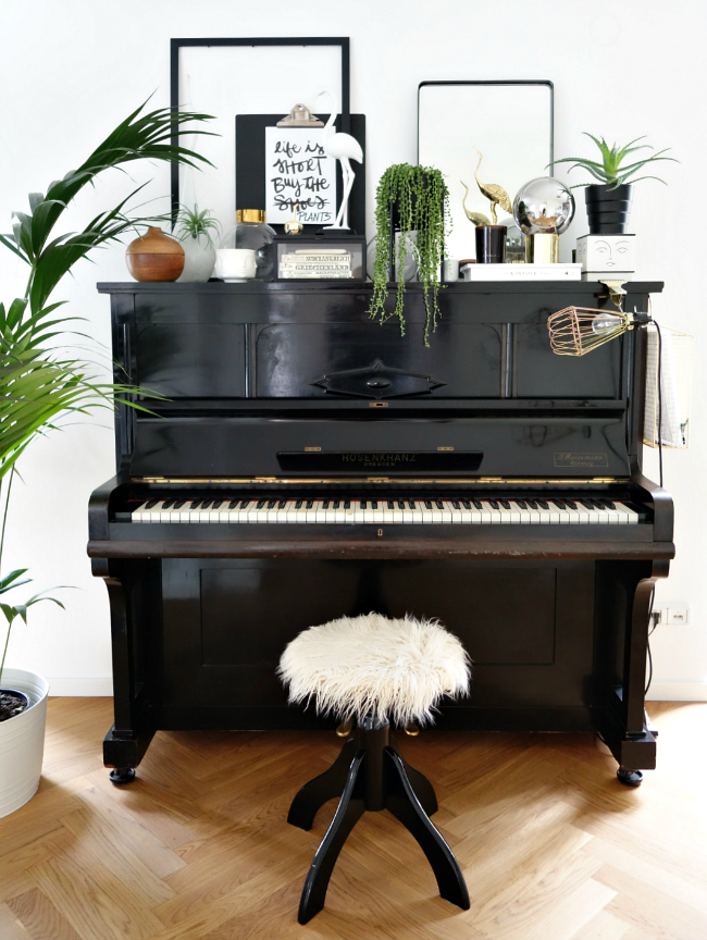 piano with plant decor