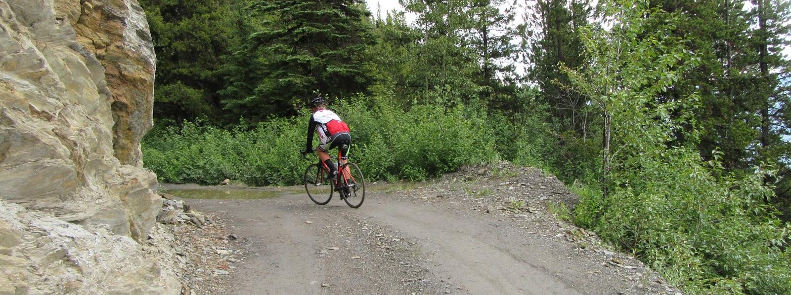 Bike climb of McBride Peak - cyclist on dirt road