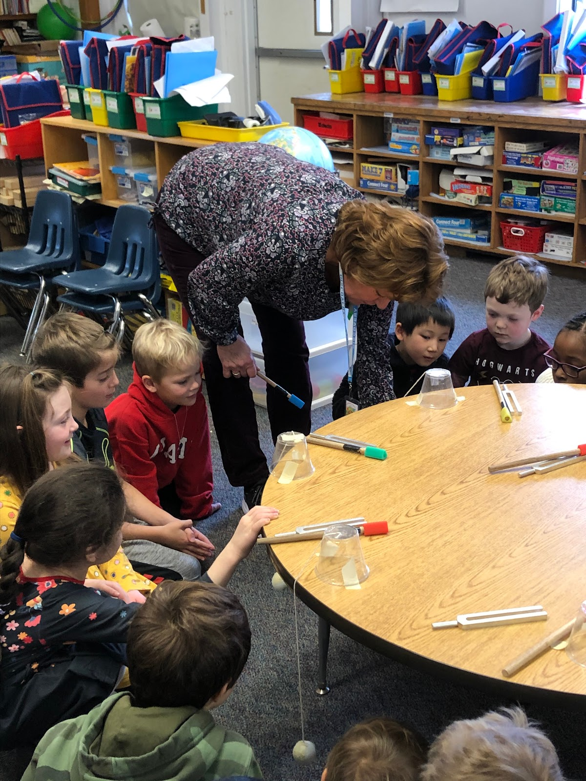Children learning about sound with a teacher from Discovery Museum