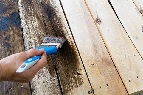 Painting wooden decking to maintain it